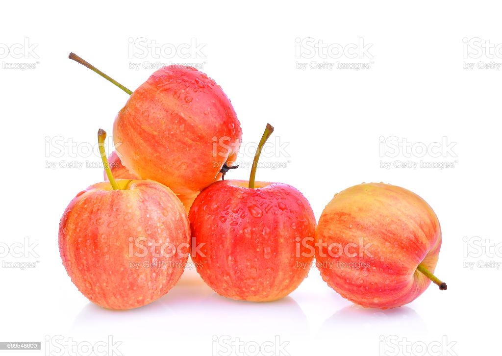 Dwarf Apple with drops of water isolated on white background stock photo