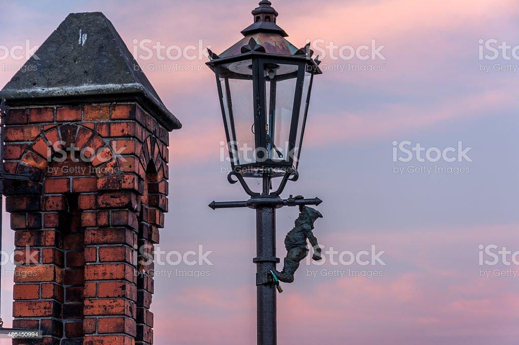 Dwarf on a lamp stock photo