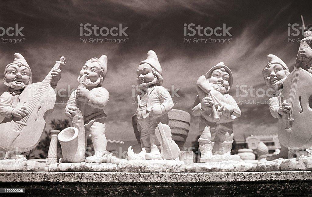 dwarfs playing music stock photo