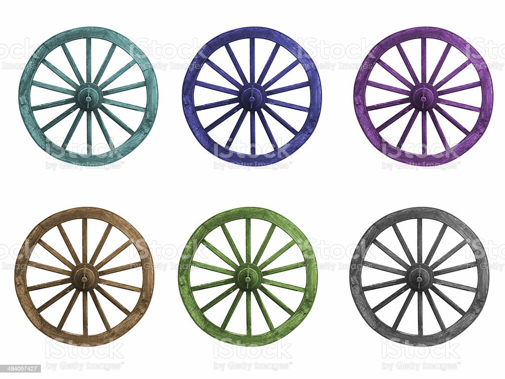 Dyed color wagon wheel on a white background. stock photo