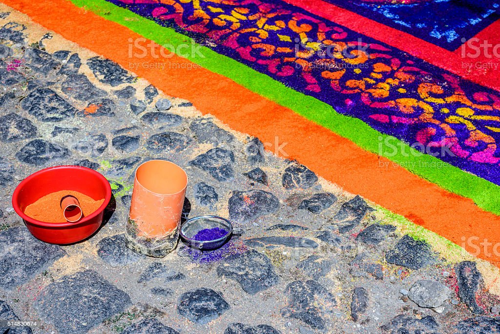 Dyed sawdust Lent carpet & tools, Antigua, Guatemala stock photo