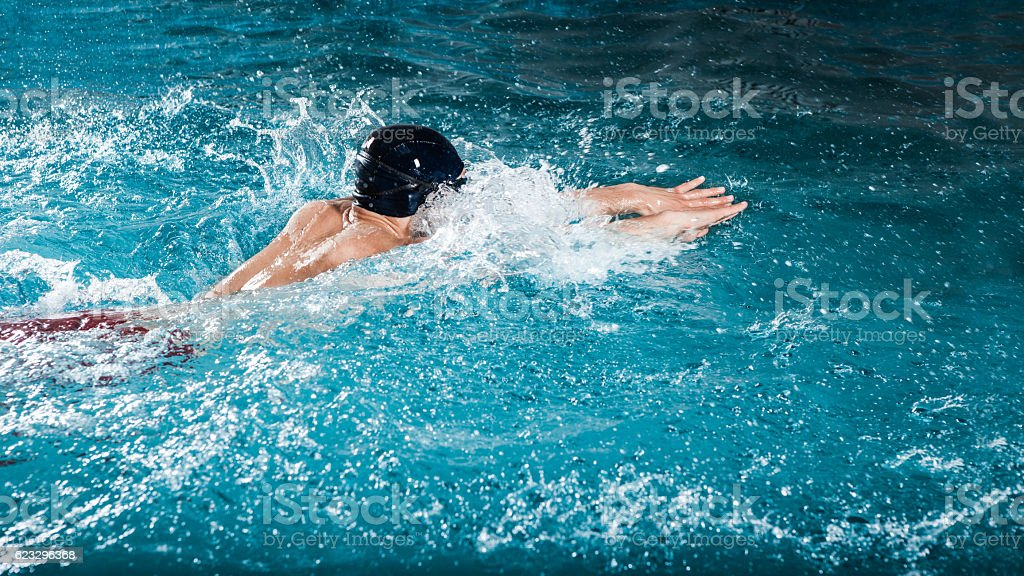 Dynamic and fit swimmer stock photo