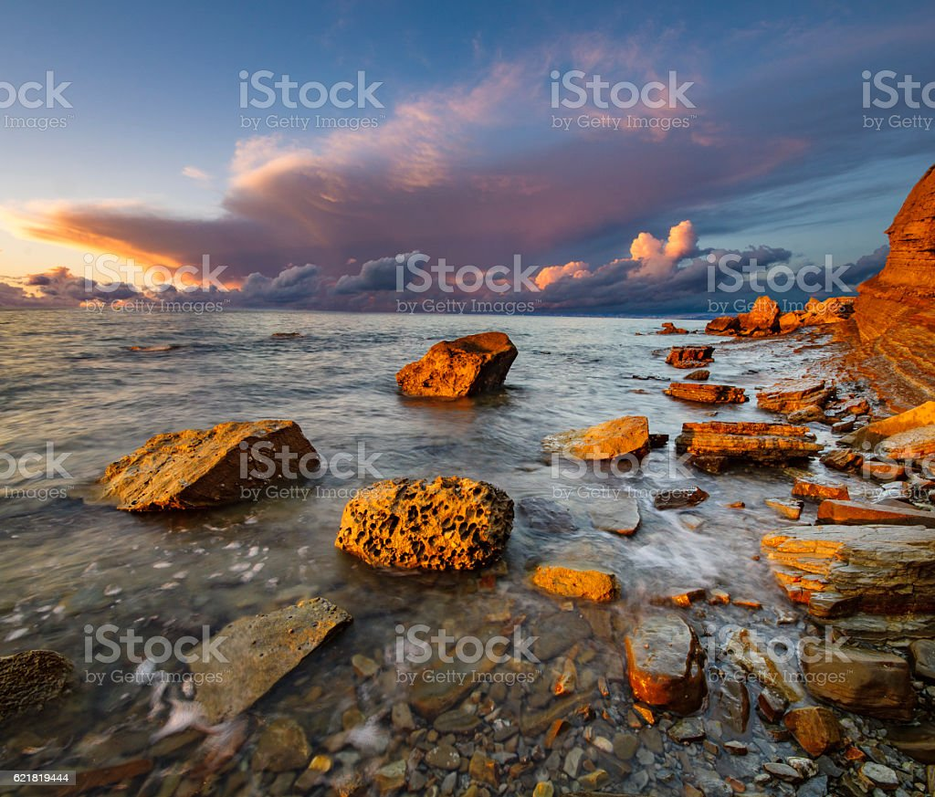 dynamic and romantic sunset over the Adriatic Sea stock photo