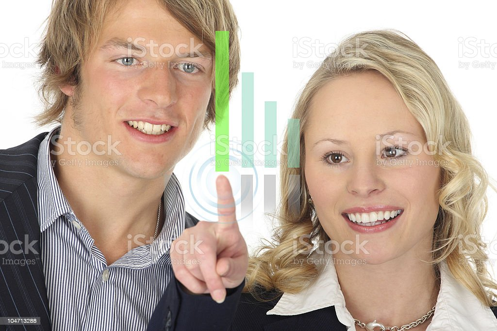 dynamic business team presenting on a virtual chart stock photo