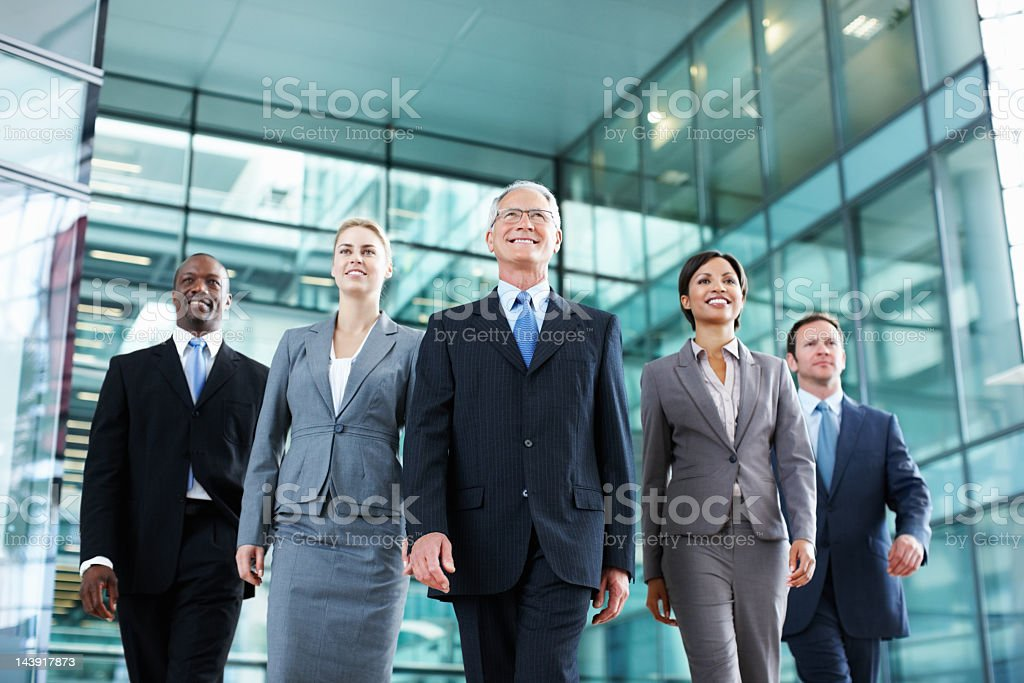 Dynamic business team walking royalty-free stock photo
