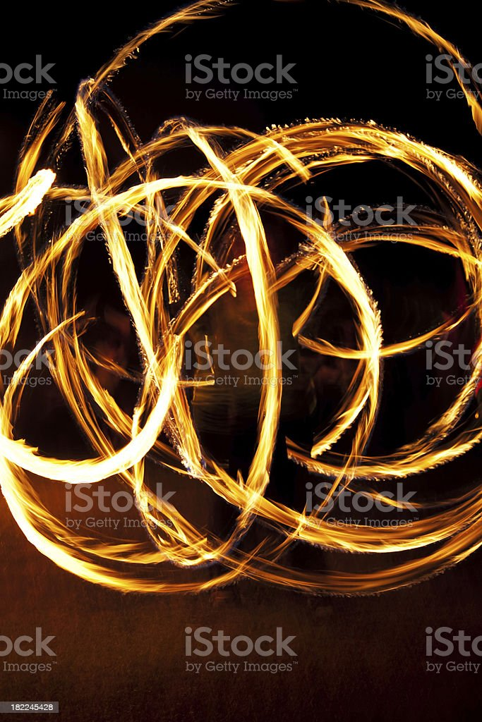 Dynamic fire dancer at night stock photo