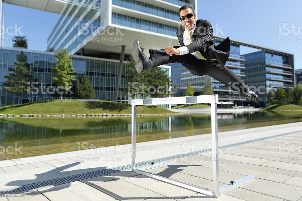 dynamic happy young business hurdler royalty-free stock photo