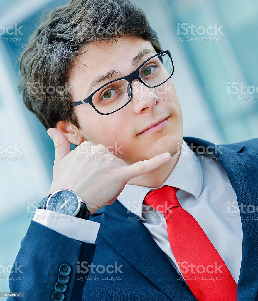 Dynamic junior executive gesturing to call royalty-free stock photo