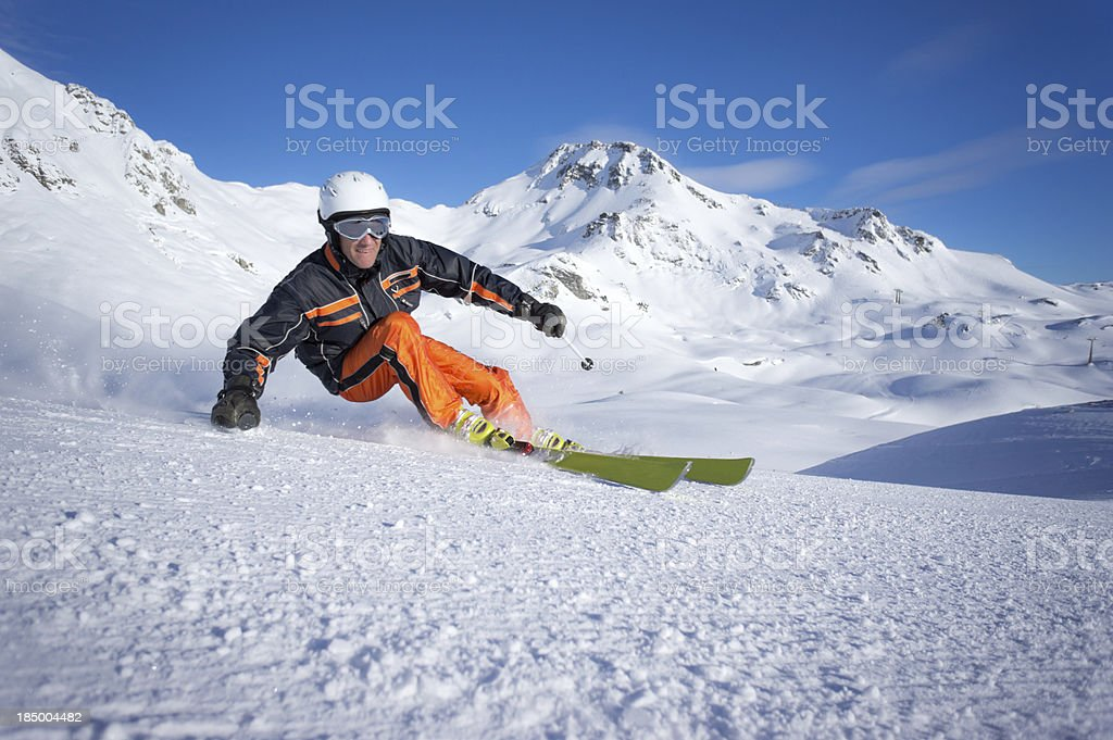 dynamic skier carving stock photo