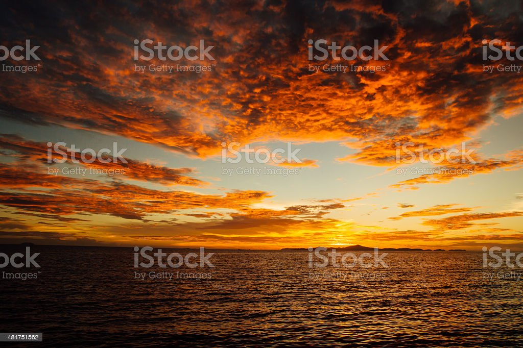 Dynamic sunset at sea stock photo