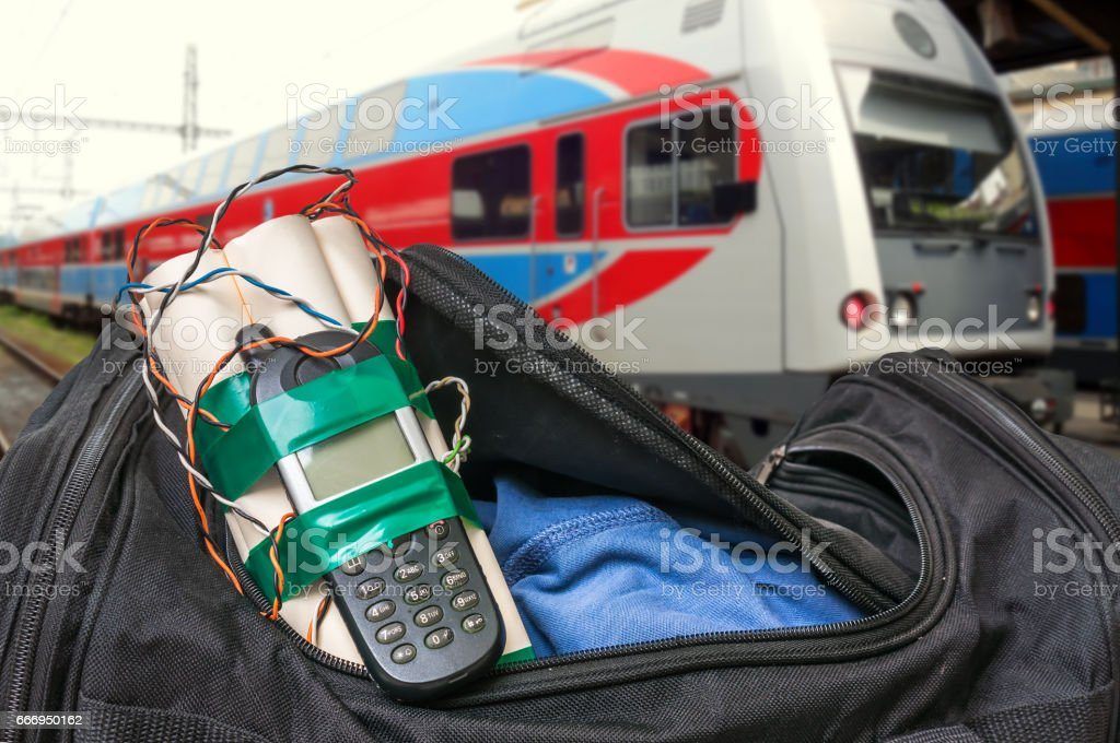Dynamite bomb with phone in terrorist bag on train station stock photo