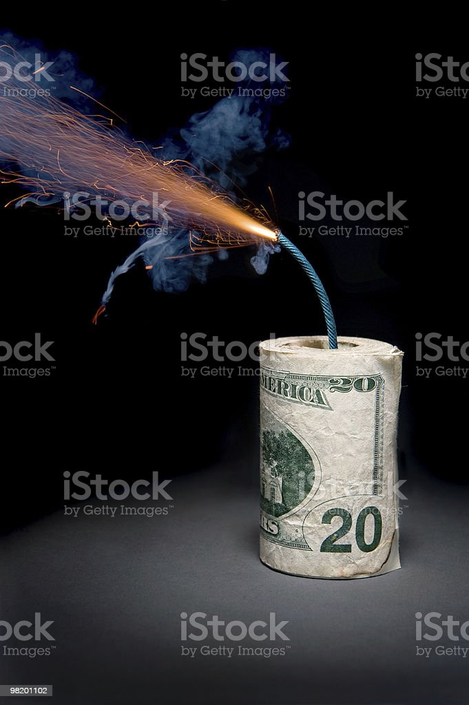 Dynamite cash with lit fuse stock photo