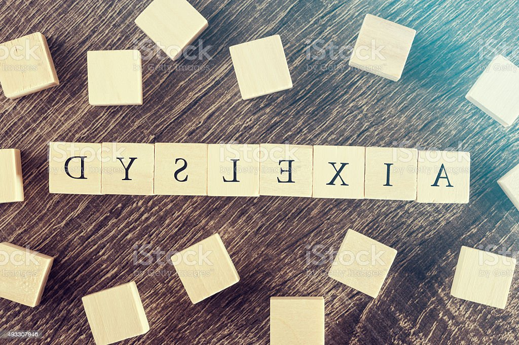 Dyslexia word formed with wooden blocks stock photo