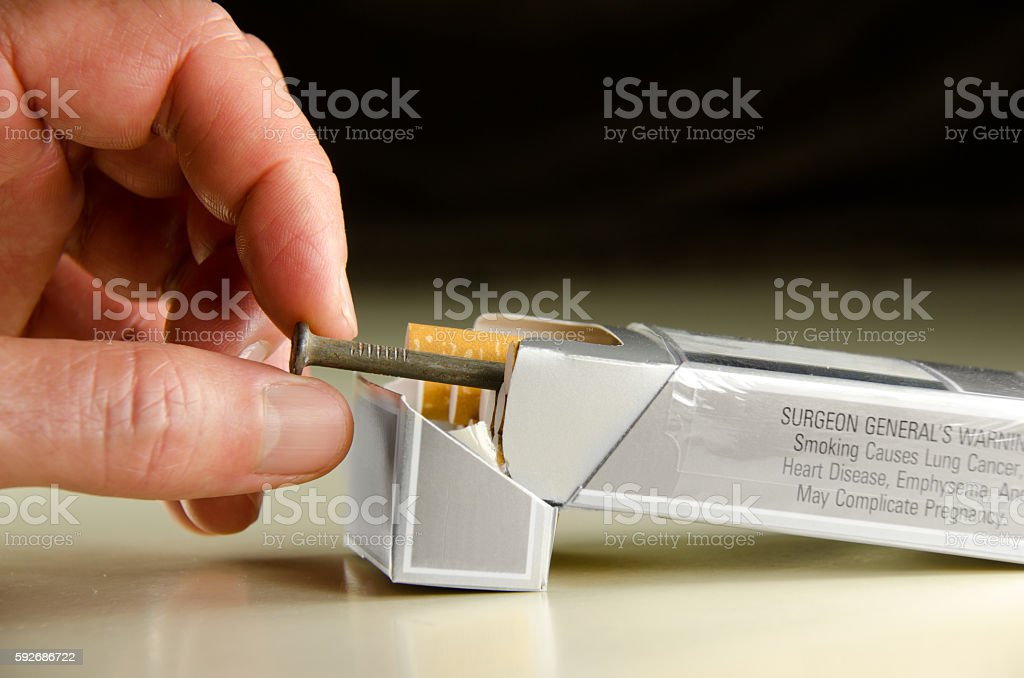Each cigarette is a nail in your coffin stock photo