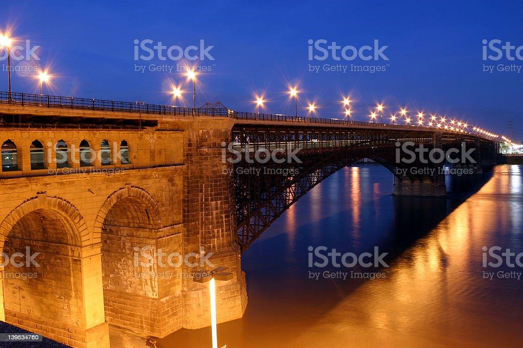 Eads Bridge St Louis  over Mississippi lights at dusk stock photo