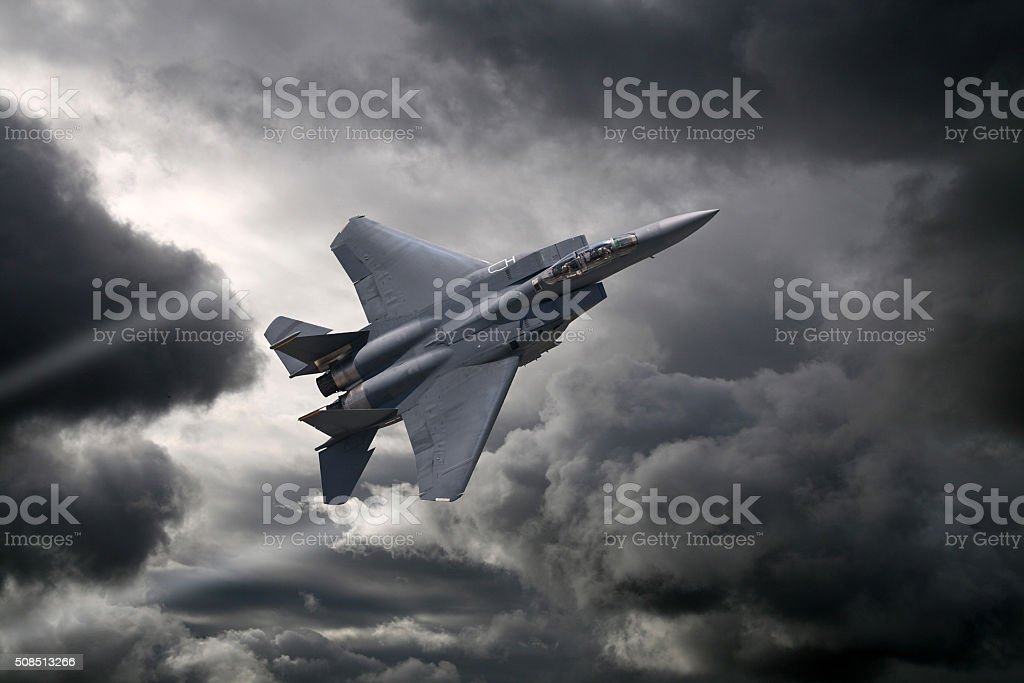 F-15 Eagle flying through the storm stock photo
