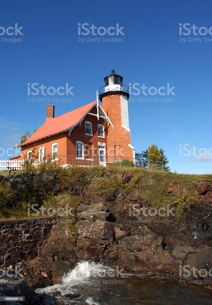 Eagle Harbor Lighthouse and Cliff stock photo