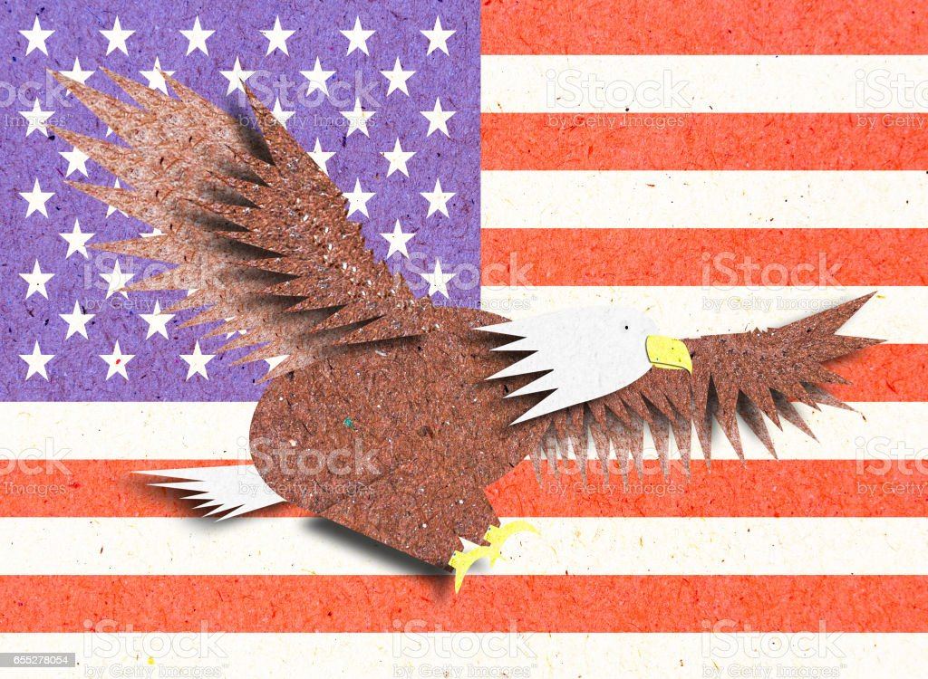 Eagle recycle paper craft with America flag stock photo