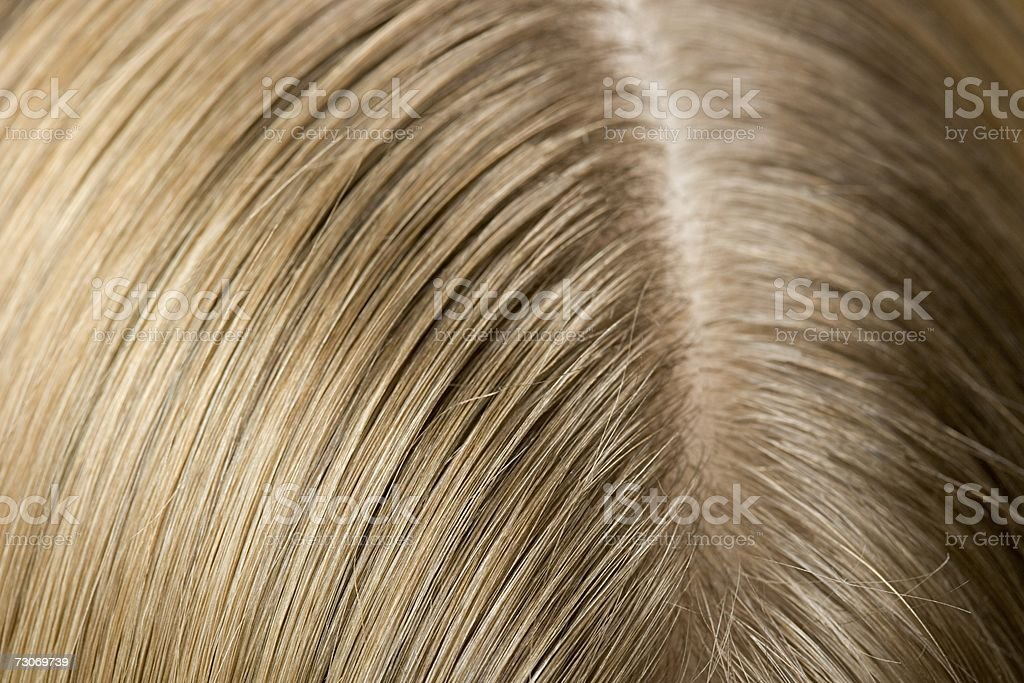 Ear and hair of a woman stock photo