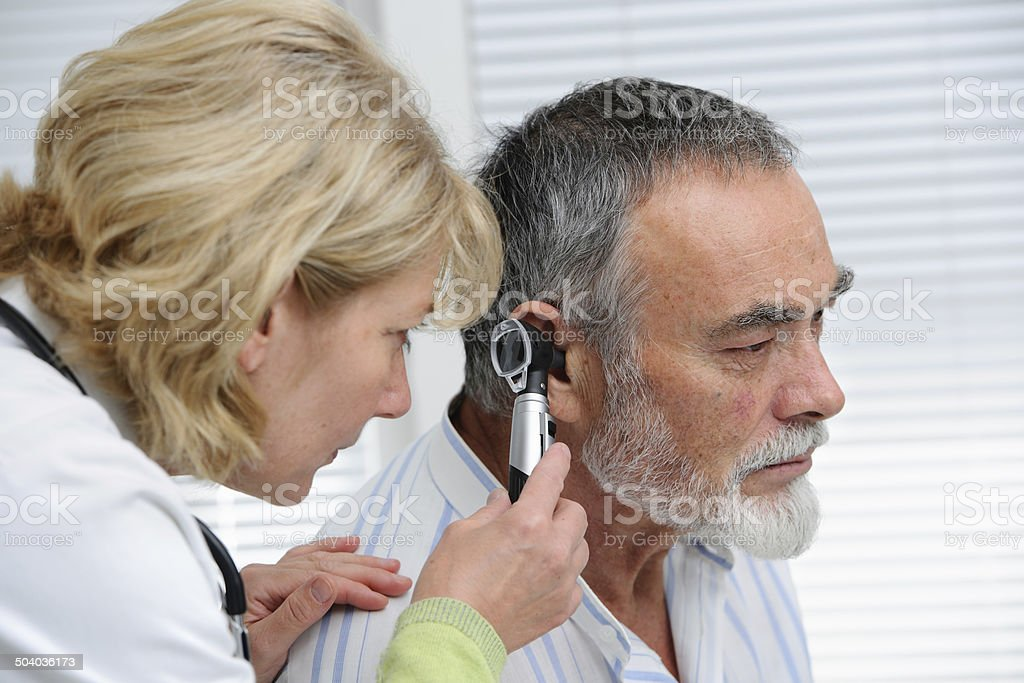 Ear examination stock photo