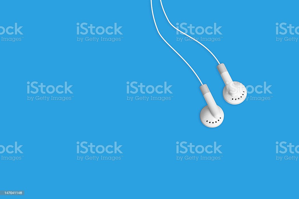Earbuds headphones listen to mp3 music royalty-free stock photo