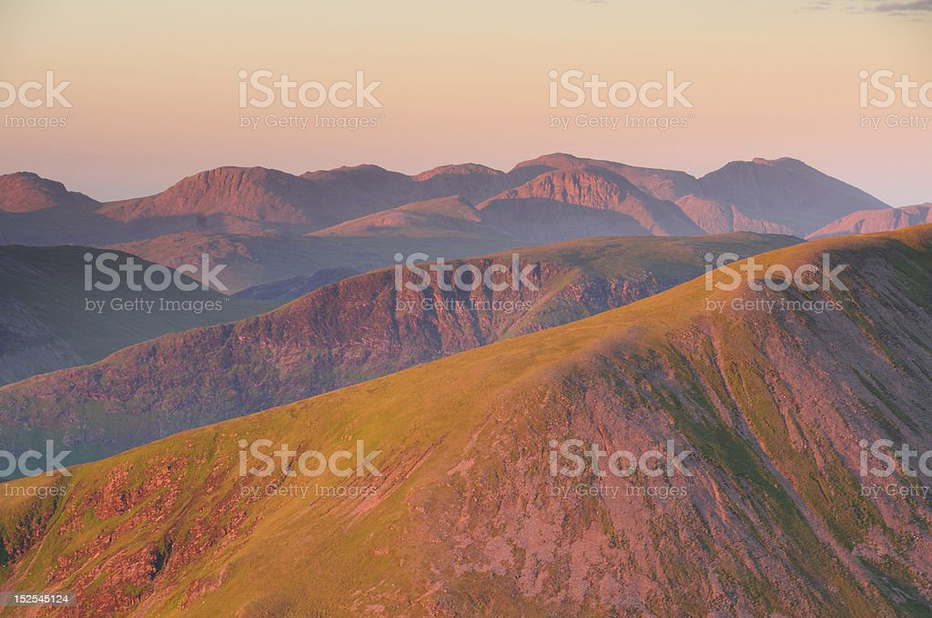 Earl morning summer sunlight on mountains in English Lake District royalty-free stock photo