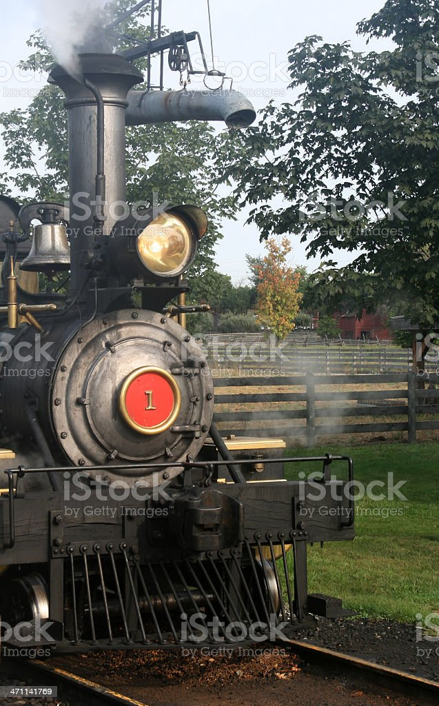 Early 1900's steam locomotive runs thru farmland in Michigan. stock photo