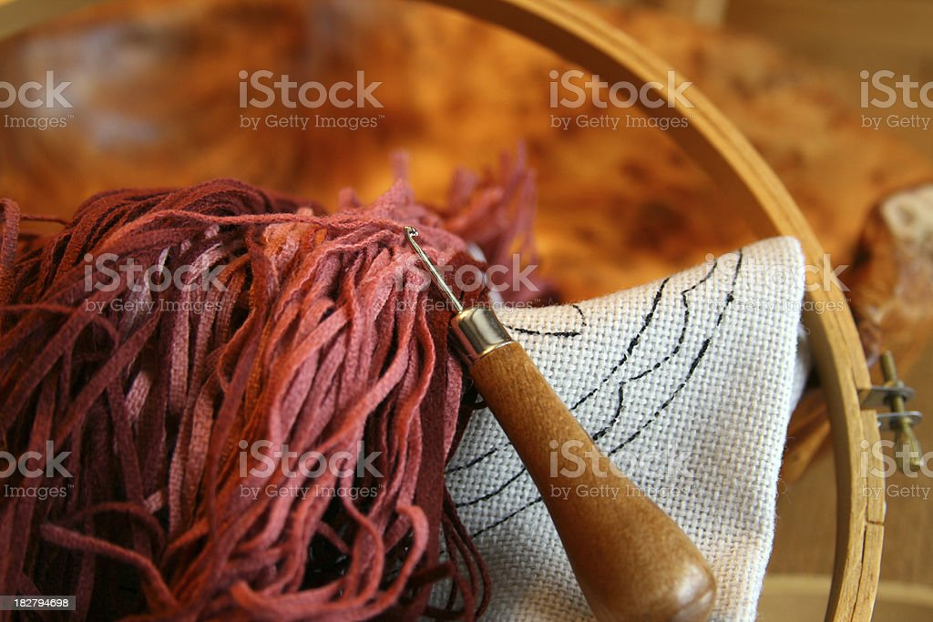 Early American Folk Art: Rug Hooking Hook and Burlap royalty-free stock photo