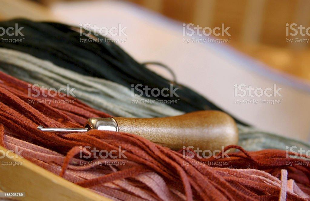 Early American Folk Art: Rug Hooking Hook, Wool, Burlap stock photo