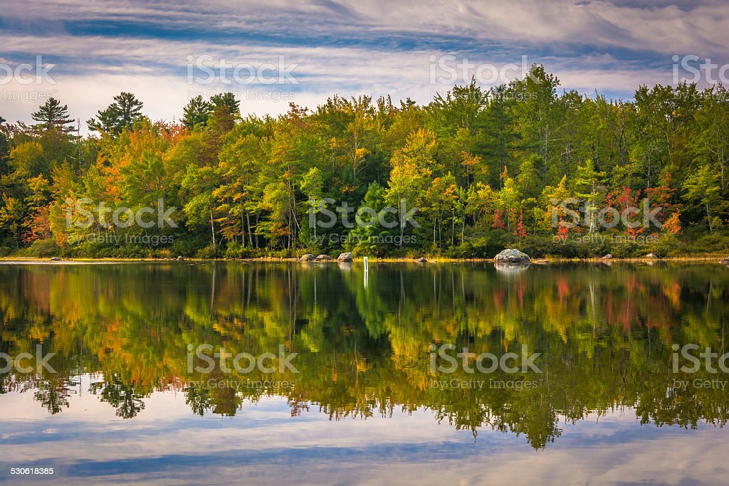 Early autumn reflections at Toddy Pond, near Orland, Maine. stock photo