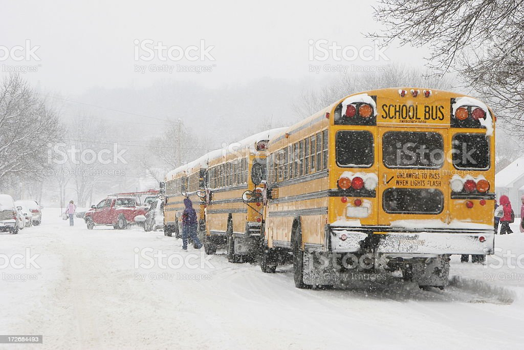 Early Dismissal-  snow and winter weather leads to school closures stock photo