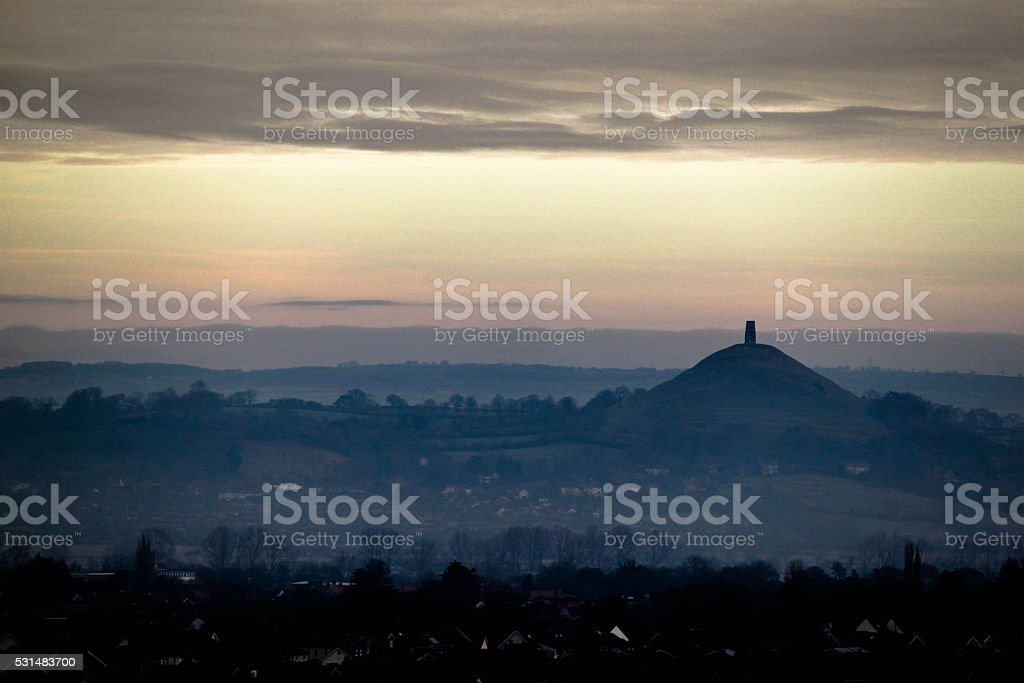 Early Evening fog rolling in over Glastonbury Tor stock photo