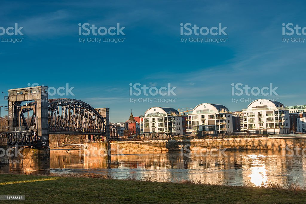 Early morning at new buildings and old bridge in Magdeburg stock photo