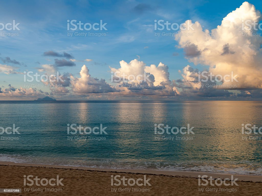 Early morning clouds near shore stock photo