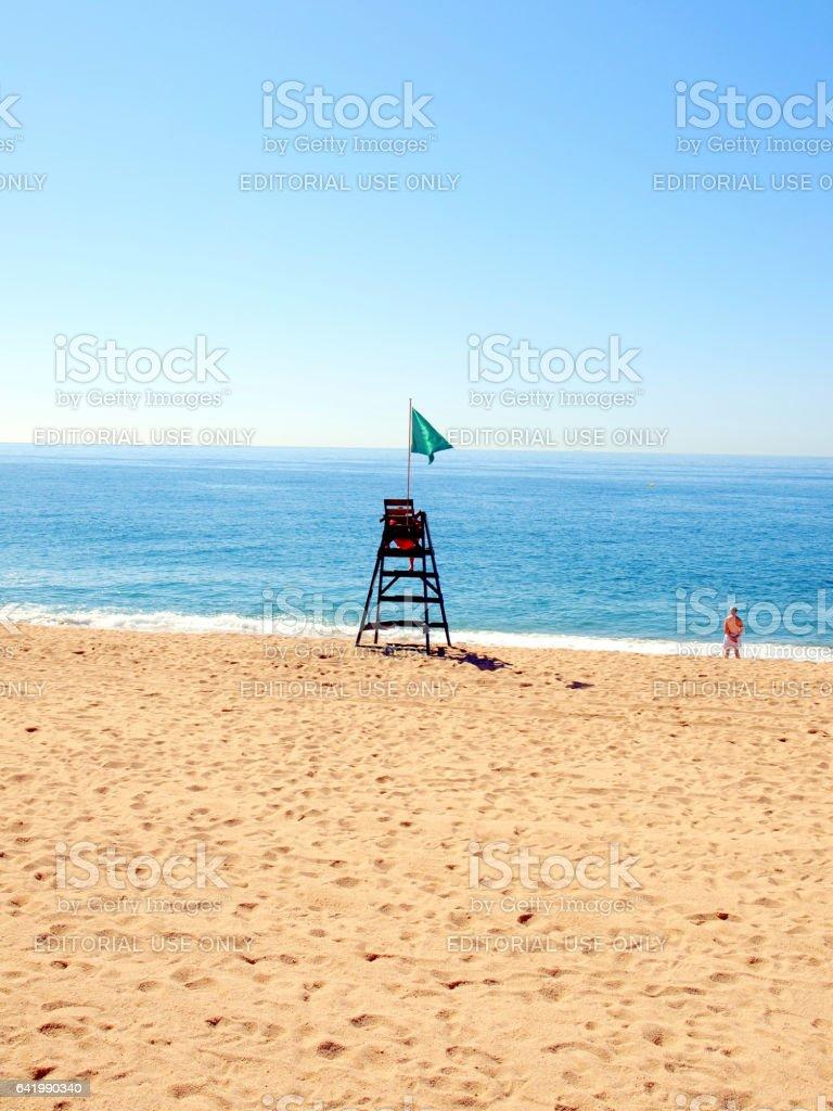 Early morning empty beach at Lloret de Mar, Spain. stock photo