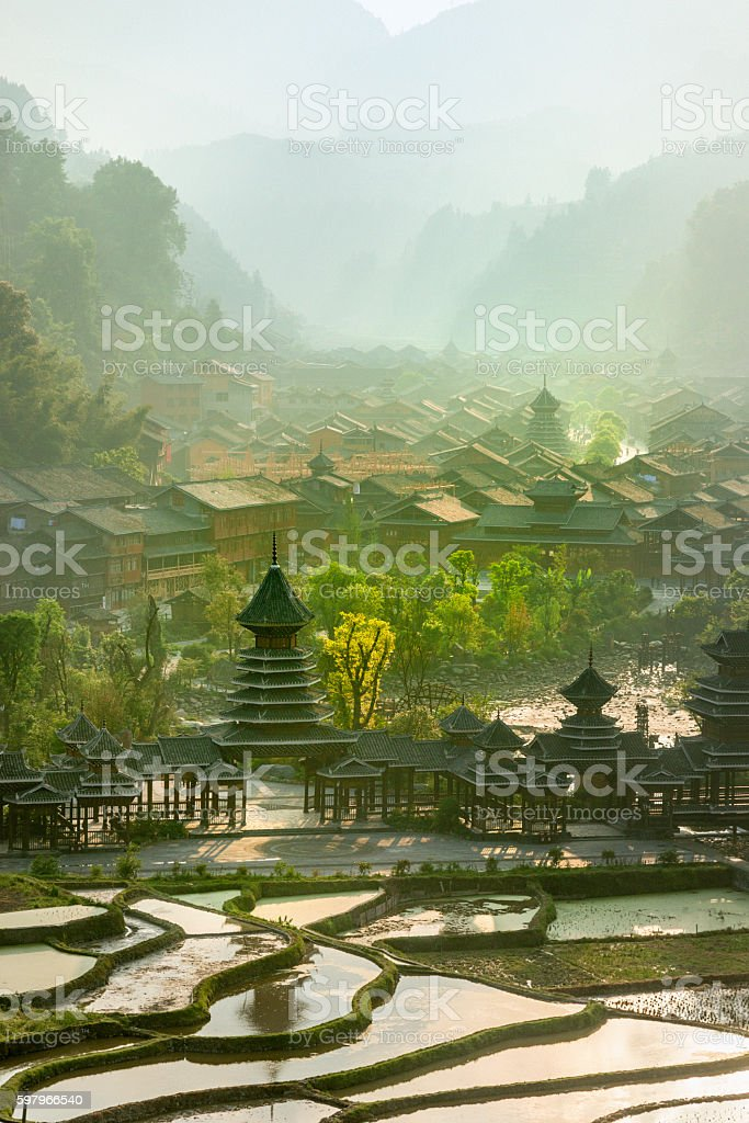 Early morning , Entrance  village Zhao Xing, rain and wind bridge. stock photo