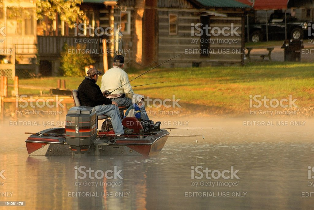 Early morning fishermen try to catch the big one stock photo