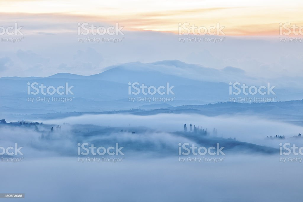 Early Morning Fog in Tuscan Landscape royalty-free stock photo