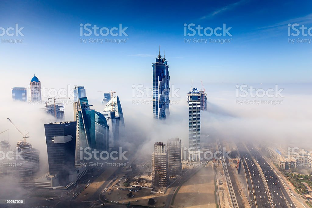 Early morning fog is covering Dubai business bay area. stock photo