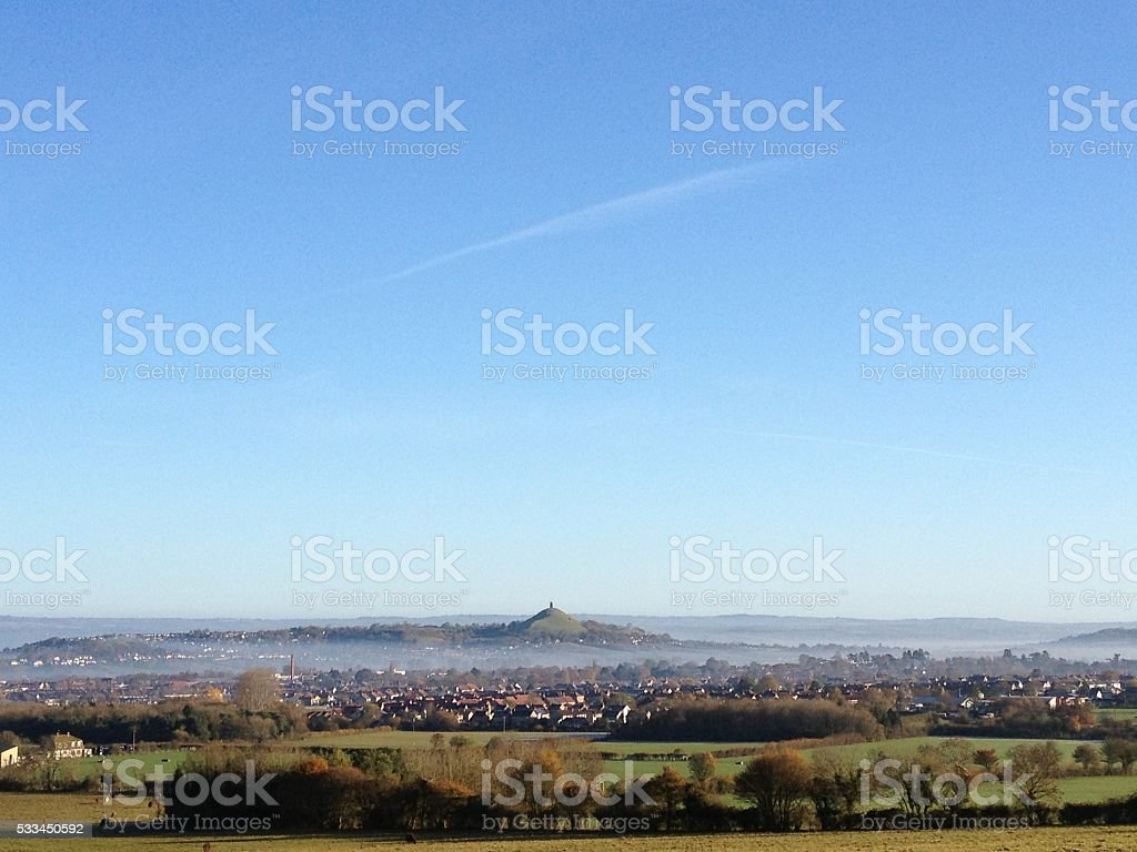 Early morning fog over Glastonbury Tor stock photo