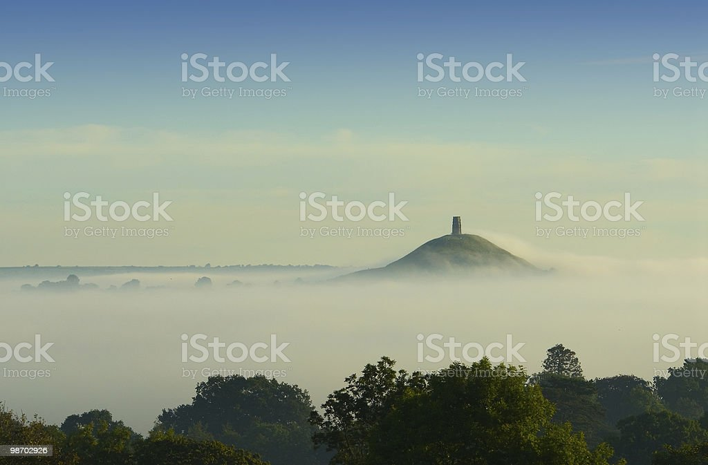 Early morning fog rolling in over Glastonbury Tor stock photo
