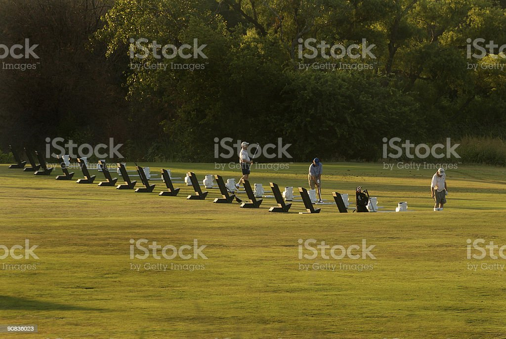 Early morning golfers stock photo