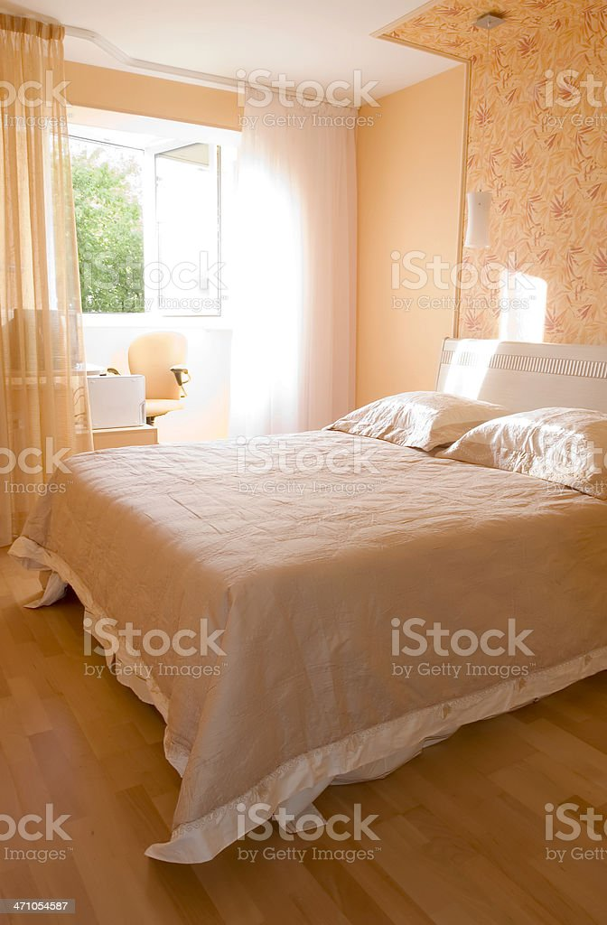 Early morning in a sunny bedroom with hardwood floors royalty-free stock photo