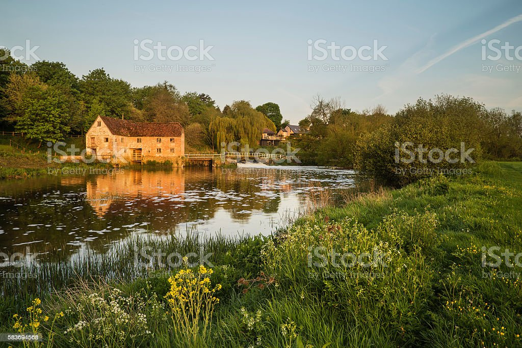 Early morning landscape across River to old water Mill stock photo