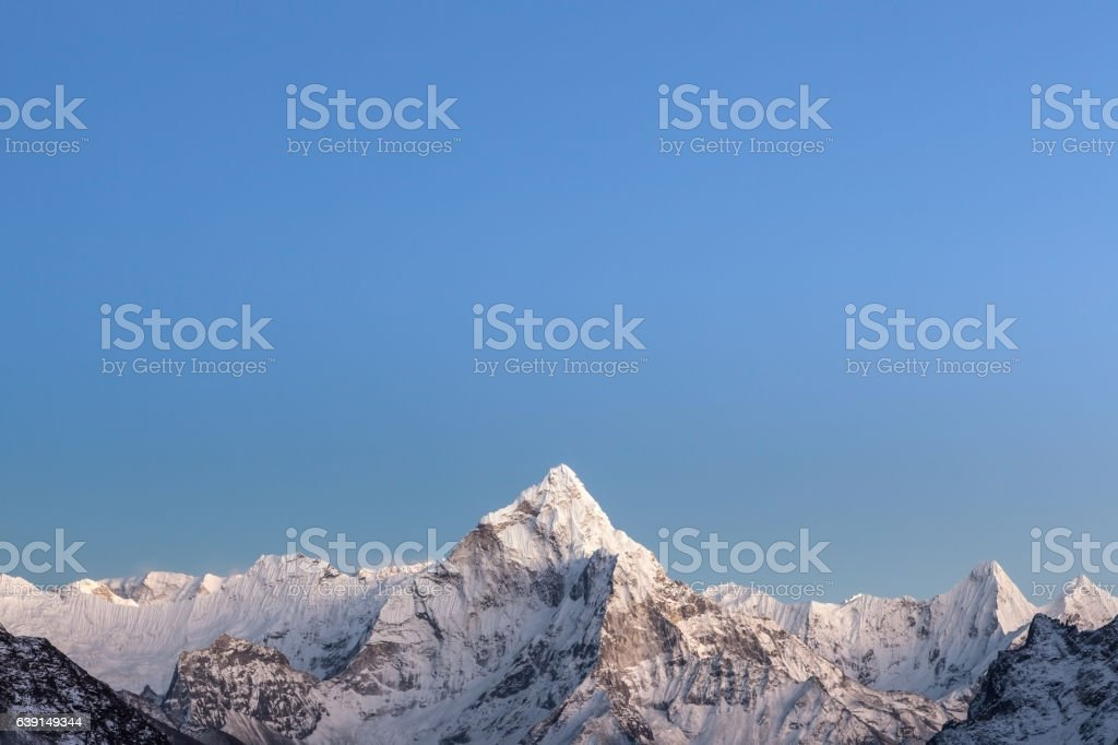 Early morning lights over the mountain Ama Dablam stock photo
