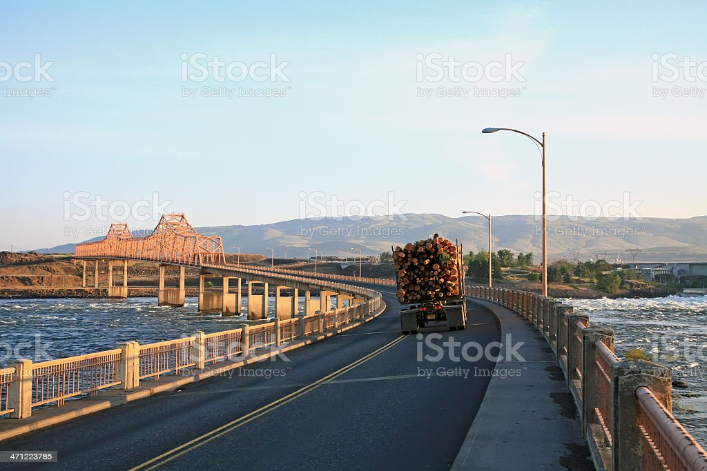 Early Morning Logging Truck Driving Over Columbia River Oregon stock photo