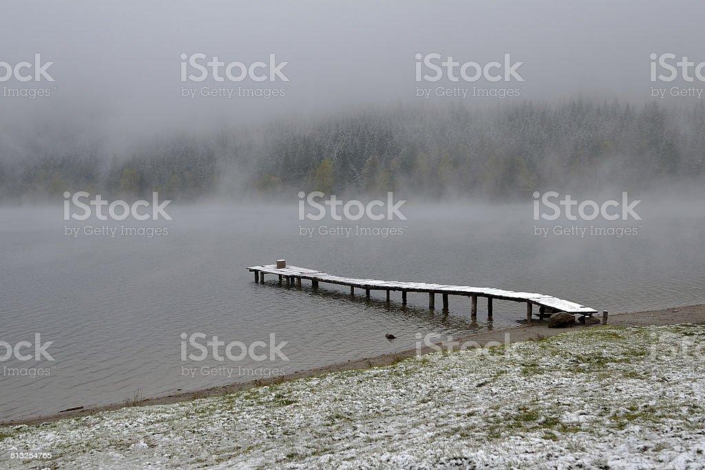 early morning mist on Lak stock photo