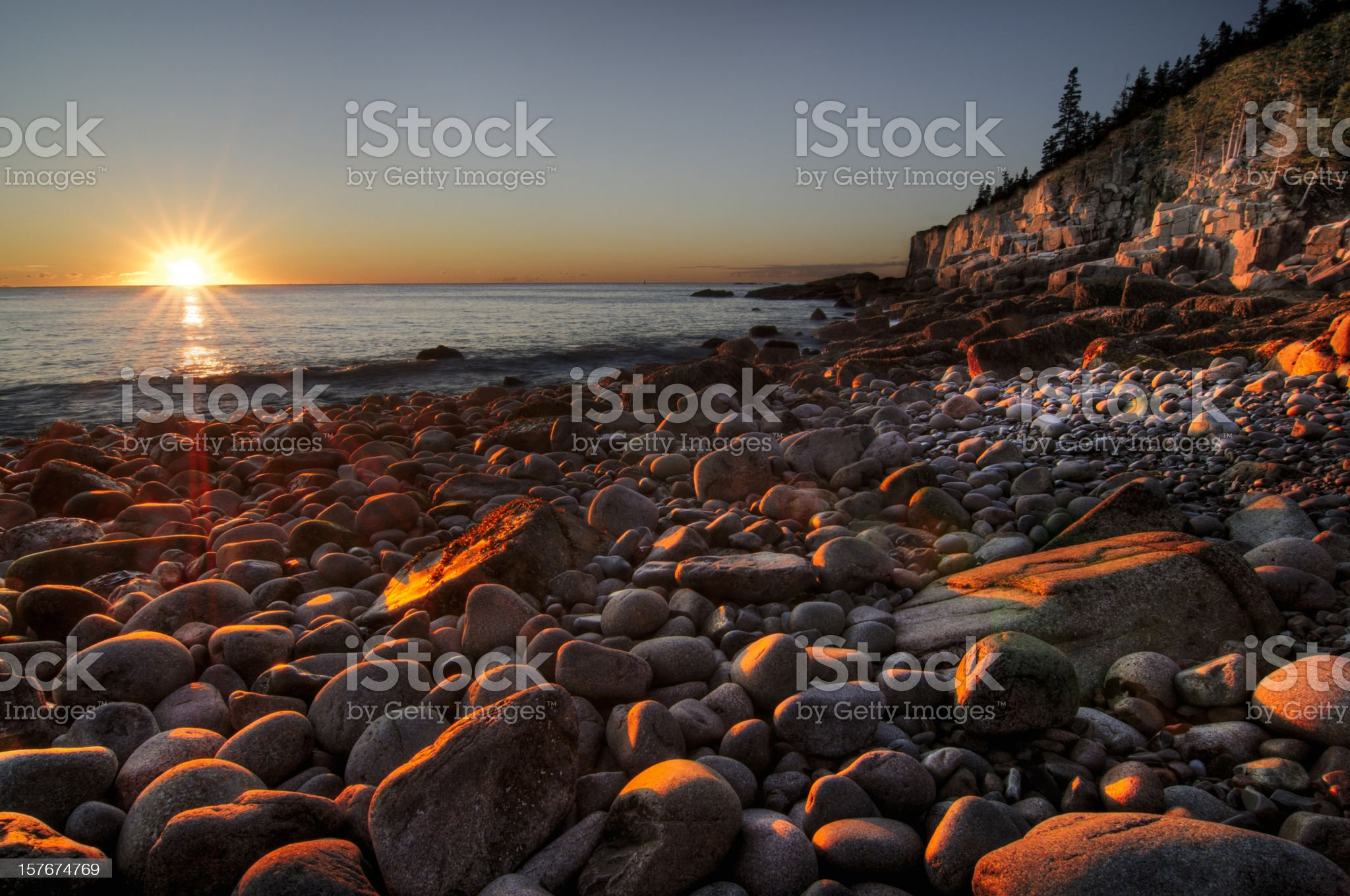 Early morning on a stone beach royalty-free stock photo