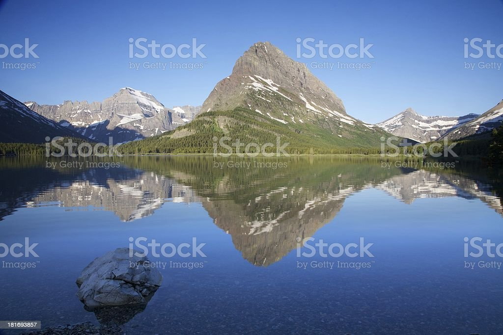 Early morning reflection of Mount Grinnell stock photo