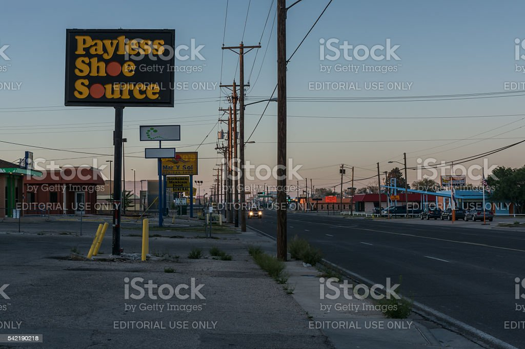 Early Morning Street with Many Signs, Poles and Wires stock photo